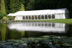 Trad marquee exterior by lake