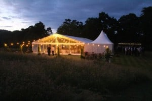 marquee tent lit up at night