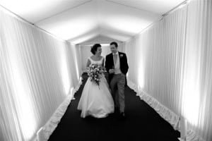 Couple in marquee walkway at wedding