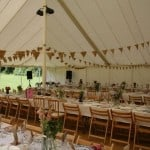 Trad marquee with bunting for wedding in Surrey