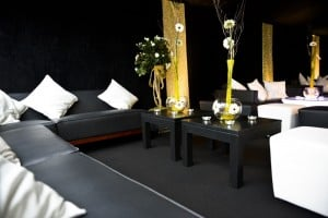 Black and white party seating in a Surrey marquee