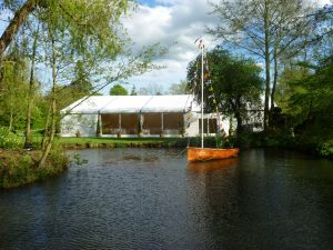 Marquee hire in Surrey, marquee over next to a lake