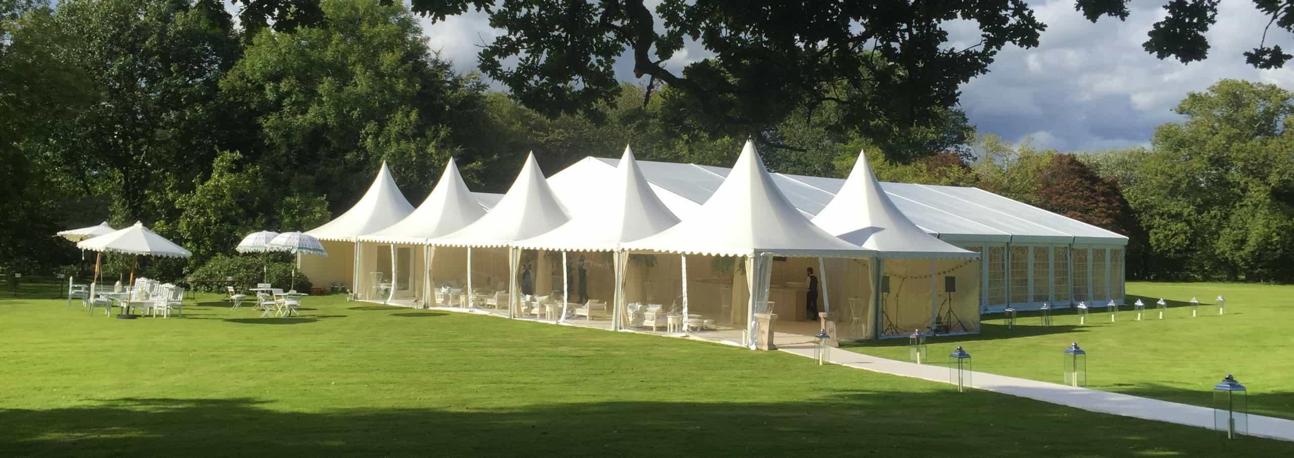 Wedding marquee hire: A large frame tent marquee with Chinese hat entrance and reception areas